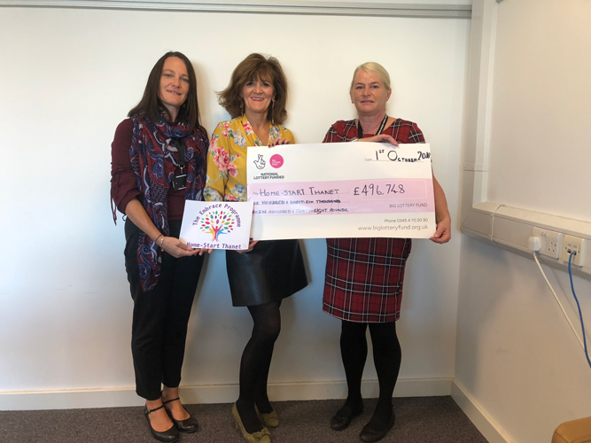 Representatives from the Big Lottery Fund presenting Home-Start Thanet with a cheque for £496,748